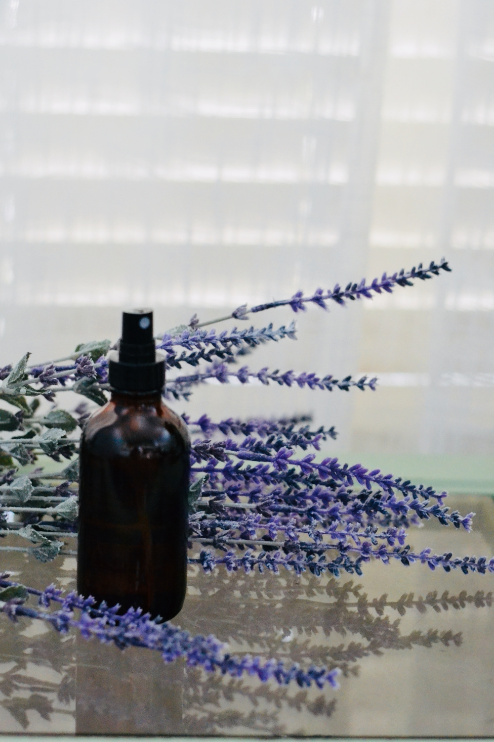 Lavender linen spray with lavender bunches on a table