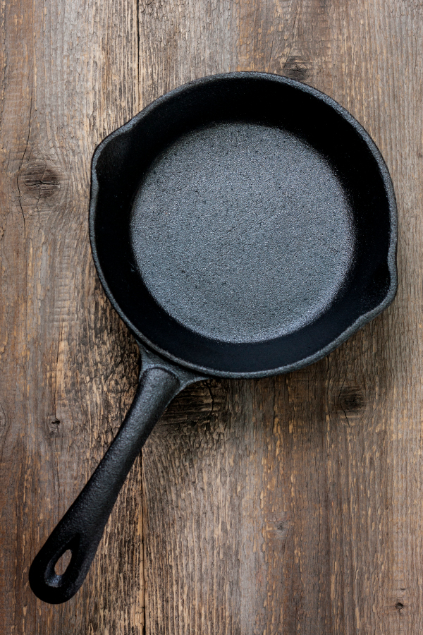 cast iron pan seasoned well on a table.