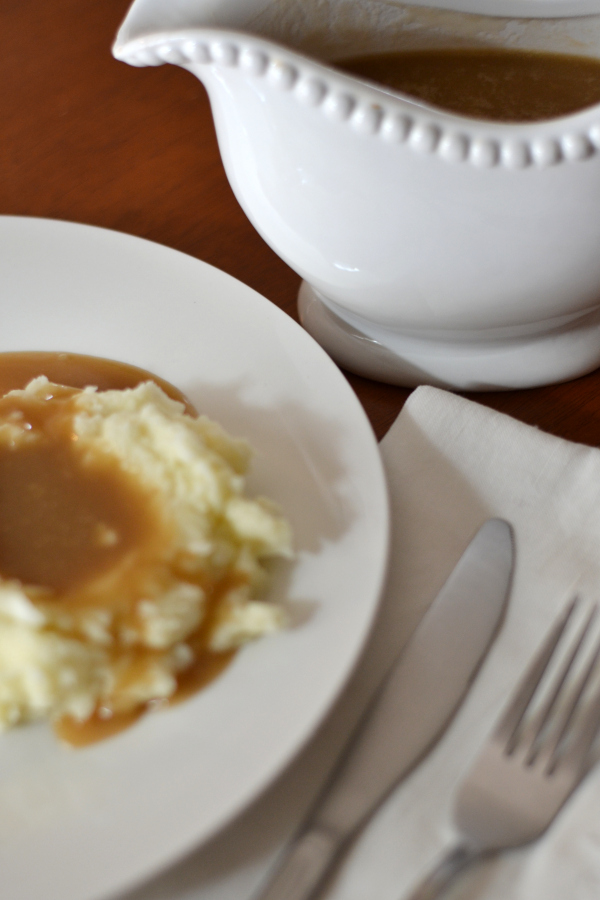 homemade gravy on mashed potatoes.