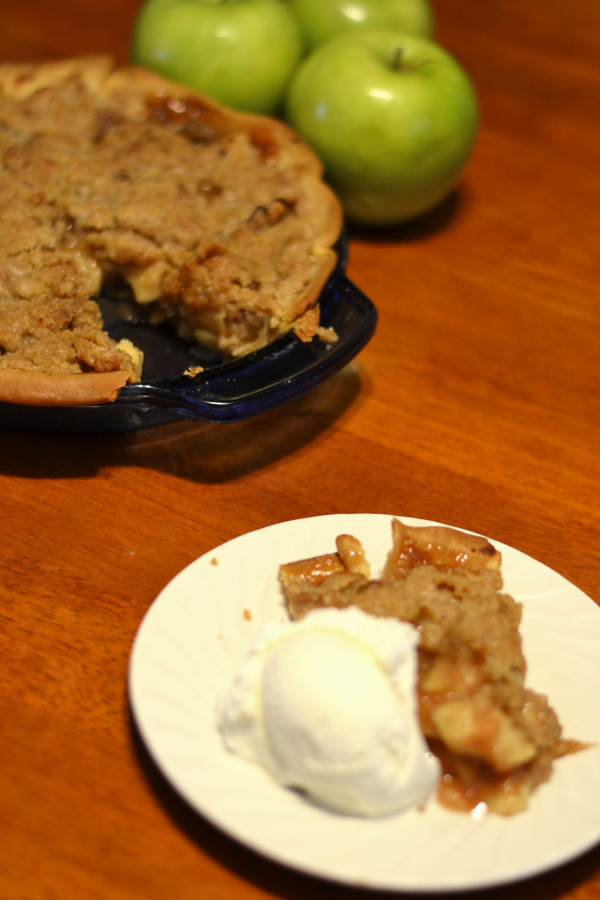 dutch apple pie sitting on a plate on a table