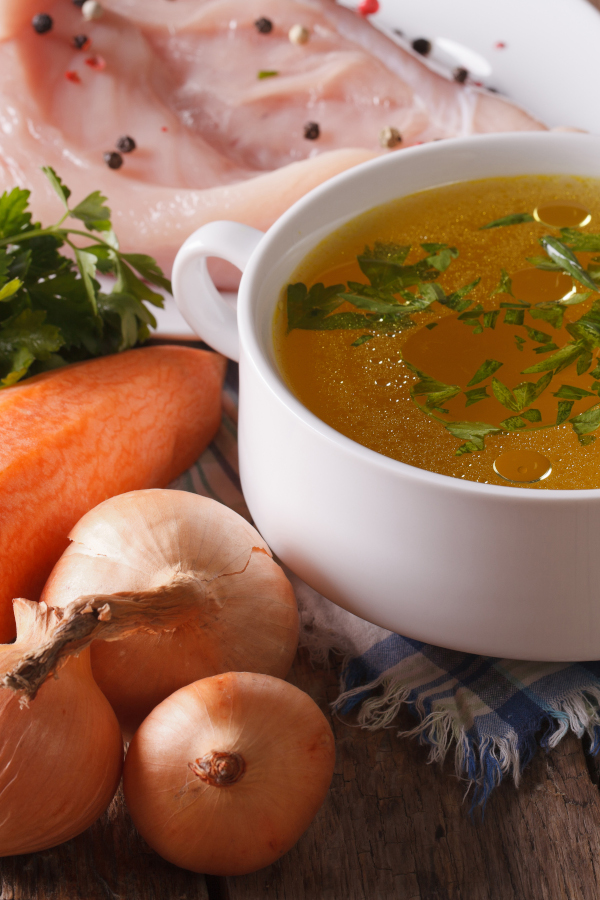 Chicken stock made from scratch from fresh ingredients in a bowl.