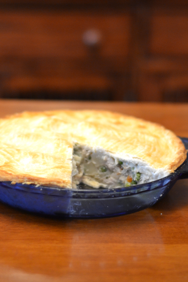 homemade chicken pot pie sitting on a table.