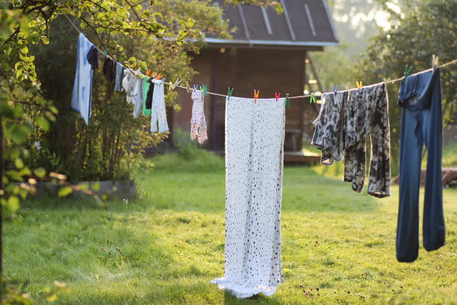 sustainably drying clothes on a clothesline outdoors