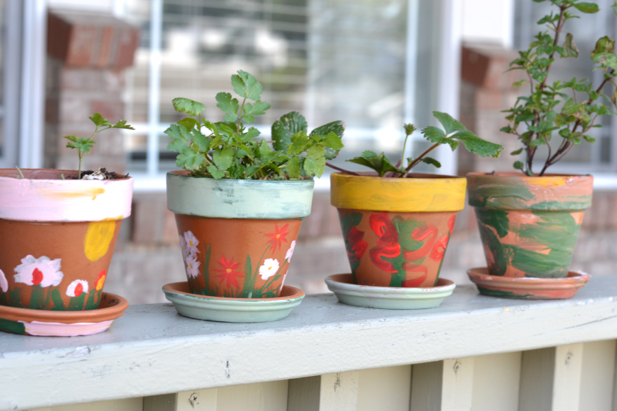 chalk painted terra cotta pots outside