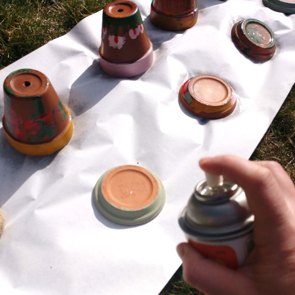 sealing the painted pots with acrylic sealer
