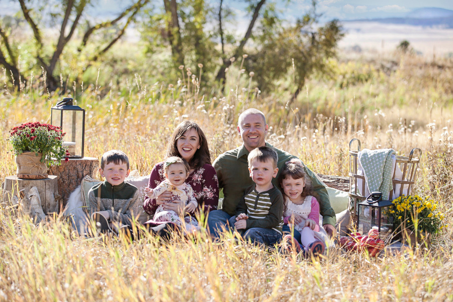 The Lavender Homefront Family Sitting in a field