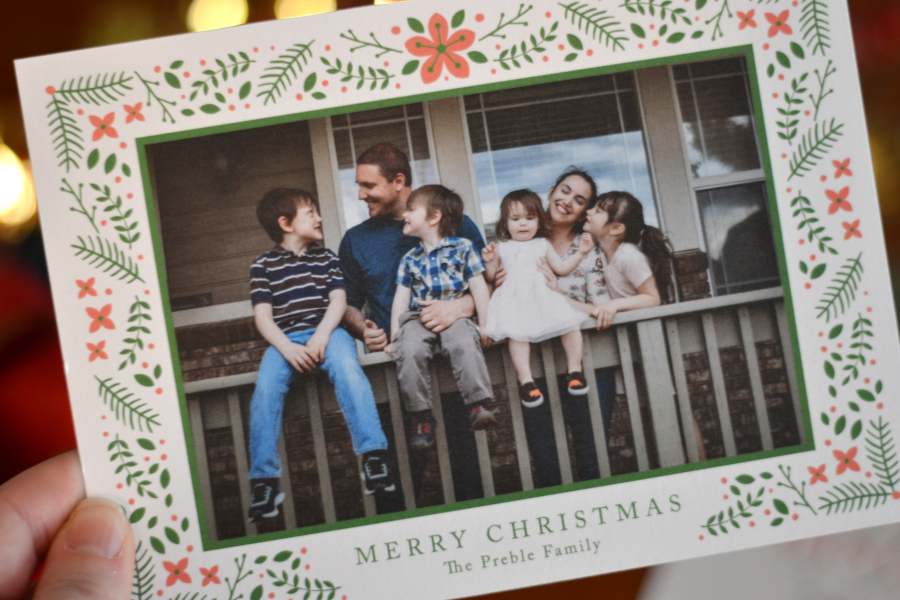 basic invite christmas invitations being held up to the camera