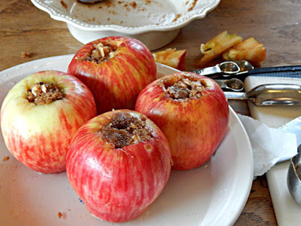 stuffed apples sitting on a plate on a table
