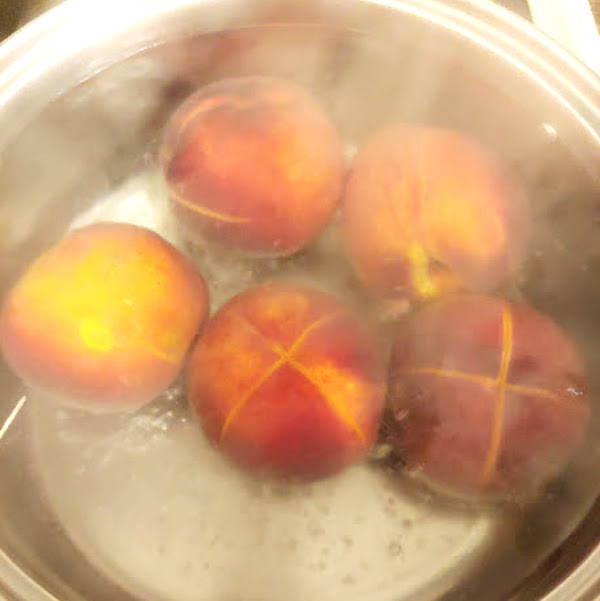 boiling peaches in a pot