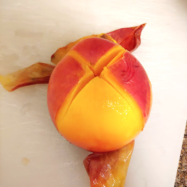 removing skin off the peaches and slicing