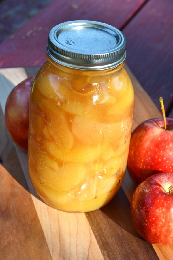 canned apple pie filling sitting on a cutting board