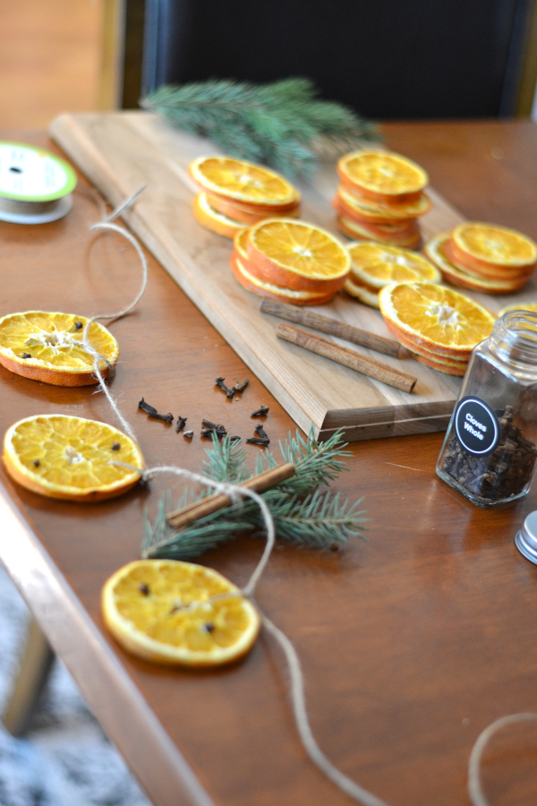 dried orange garland supplies sitting on a table