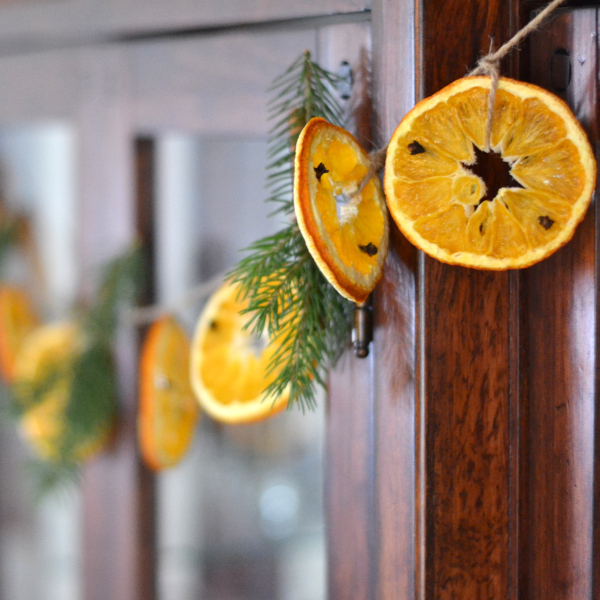 dried orange garland hanging on a wall
