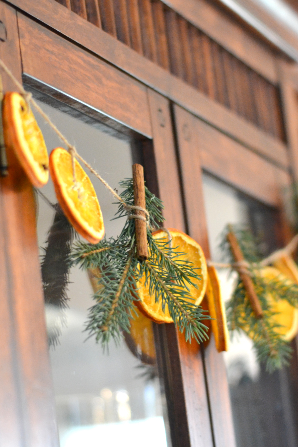 hanging dried orange garland with pine and cinnamon