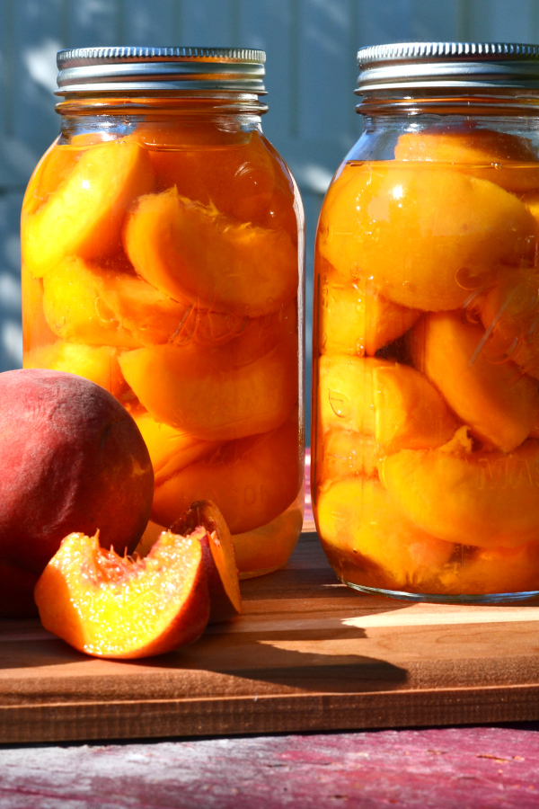 canning peaches sitting on a table