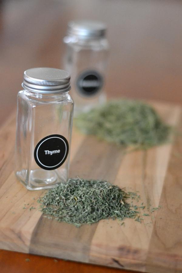 dried herbs sitting on a cutting board