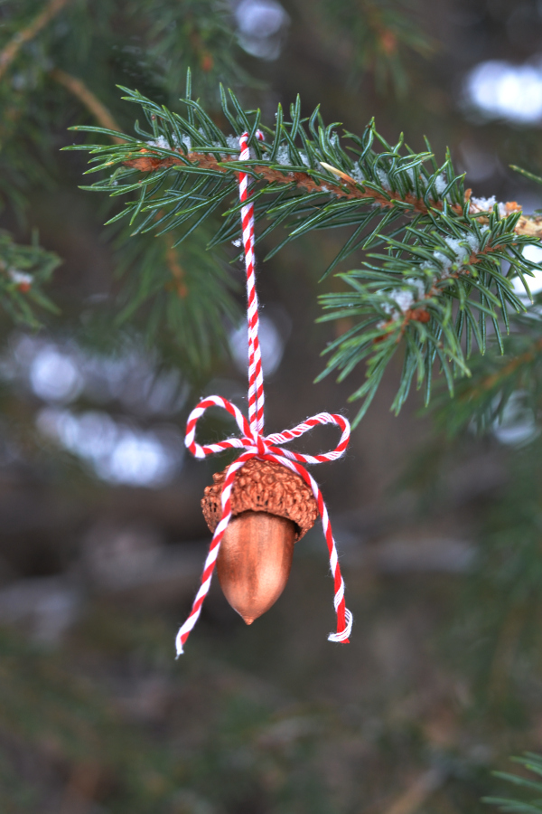 handmade acorn ornament hanging on a tree