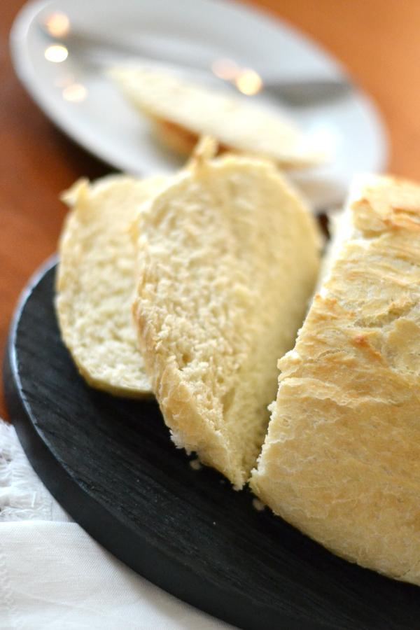 Delicious bread recipe artisan bread on a small cutting board.