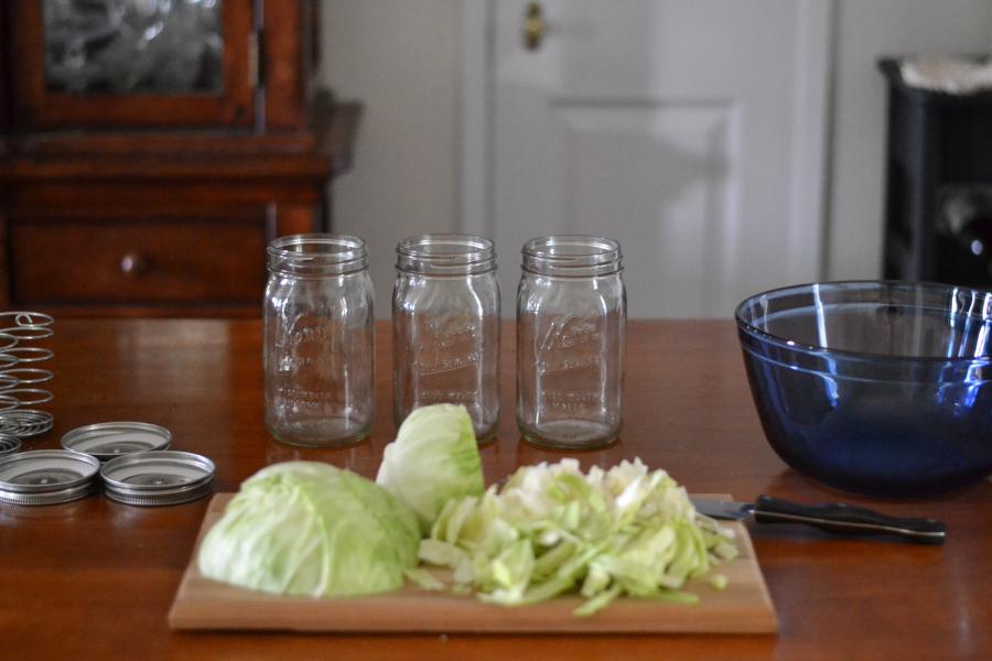 Equipment needed to make homemade sauerkraut.