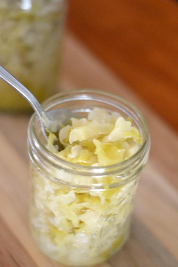 Homemade sauerkraut in a mason jar ready to serve.